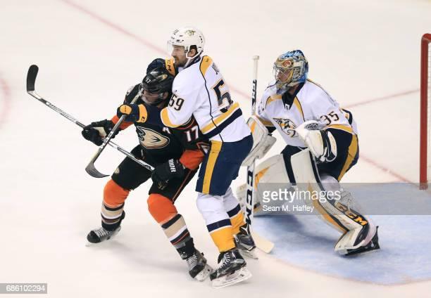 Roman Josi of the Nashville Predators defends Ryan Kesler of the Anaheim Ducks in front of goaltender Pekka Rinne of the Nashville Predators in the...