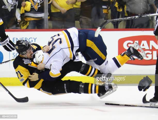 Roman Josi of the Nashville Predators fights with Evgeni Malkin of the Pittsburgh Penguins in Game Five of the 2017 NHL Stanley Cup Final at the PPG...