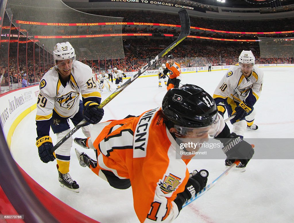 Roman Josi #59 of the Nashville Predators hits Travis Konecny #11 of the Philadelphia Flyers during the second period at the Wells Fargo Center on December 19, 2016 in Philadelphia, Pennsylvania.
