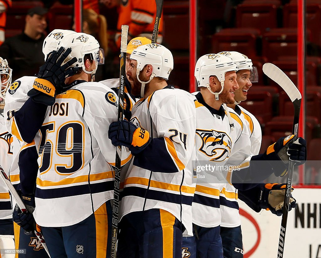 <a gi-track='captionPersonalityLinkClicked' href=/galleries/search?phrase=Roman+Josi&family=editorial&specificpeople=4247871 ng-click='$event.stopPropagation()'>Roman Josi</a> #59 of the Nashville Predators is congratulated by teamamte <a gi-track='captionPersonalityLinkClicked' href=/galleries/search?phrase=Eric+Nystrom&family=editorial&specificpeople=2209813 ng-click='$event.stopPropagation()'>Eric Nystrom</a> #24 after Josi scored the game winner in a shootout against the Philadelphia Flyers at Wells Fargo Center on January 16, 2014 in Philadelphia, Pennsylvania.The Nashville Predators defeated the Philadelphia Flyers 4-3 in an overtime shootout.