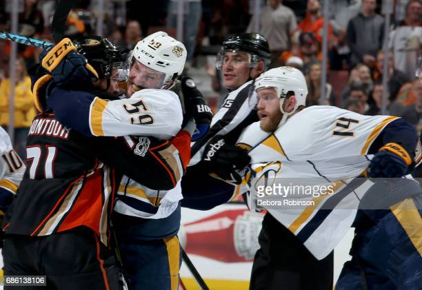 Roman Josi of the Nashville Predators mixes it up with Brandon Montour of the Anaheim Ducks in Game Five of the Western Conference Final during the...