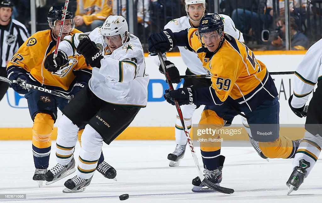 Roman Josi #59 of the Nashville Predators races for the puck against Ryan Garbutt #40 of the Dallas Stars during an NHL game at the Bridgestone Arena on February 25, 2013 in Nashville, Tennessee.