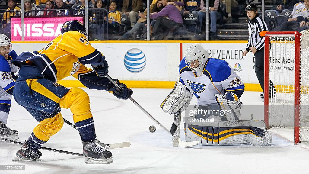 <a gi-track='captionPersonalityLinkClicked' href=/galleries/search?phrase=Roman+Josi&family=editorial&specificpeople=4247871 ng-click='$event.stopPropagation()'>Roman Josi</a> #59 of the Nashville Predators shoots the puck against Ryan Miller #39 of the St. Louis Blues at Bridgestone Arena on March 6, 2014 in Nashville, Tennessee.