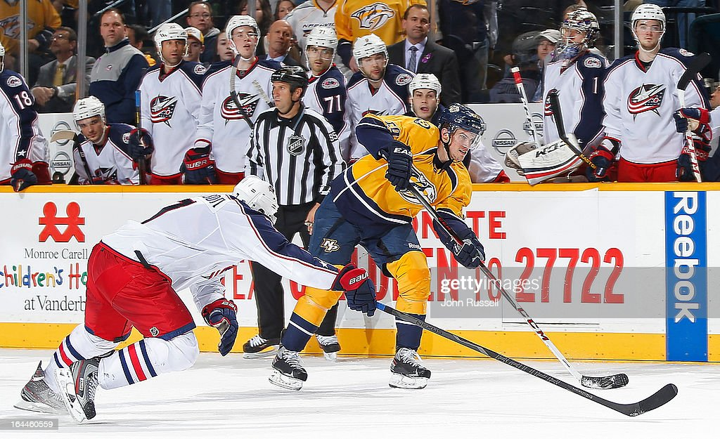 <a gi-track='captionPersonalityLinkClicked' href=/galleries/search?phrase=Roman+Josi&family=editorial&specificpeople=4247871 ng-click='$event.stopPropagation()'>Roman Josi</a> #59 of the Nashville Predators shoots the puck into an empty net against the Columbus Blue Jackets during an NHL game at the Bridgestone Arena on March 23, 2013 in Nashville, Tennessee.