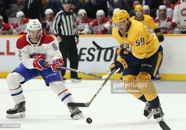 Roman Josi of the Nashville Predators skates against Jonathan Drouin of the Montreal Canadiens during the third period at Bridgestone Arena on...