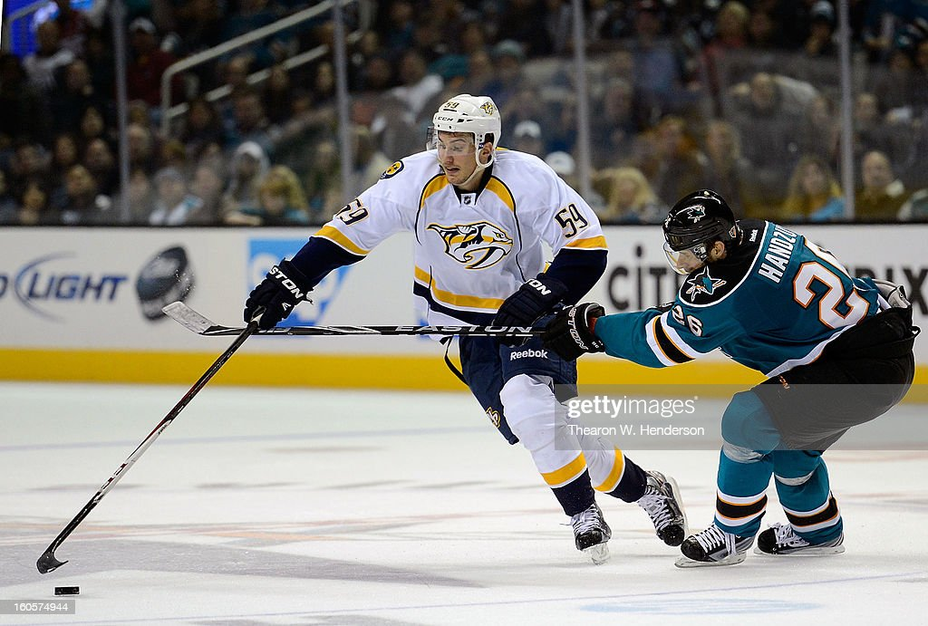 <a gi-track='captionPersonalityLinkClicked' href=/galleries/search?phrase=Roman+Josi&family=editorial&specificpeople=4247871 ng-click='$event.stopPropagation()'>Roman Josi</a> #59 of the Nashville Predators skates to gain control of the puck away from <a gi-track='captionPersonalityLinkClicked' href=/galleries/search?phrase=Michal+Handzus&family=editorial&specificpeople=201537 ng-click='$event.stopPropagation()'>Michal Handzus</a> #26 of the San Jose Sharks in the third period of their game at HP Pavilion on February 2, 2013 in San Jose, California. The Predators won the game in an overtime shoot-out 2-1.