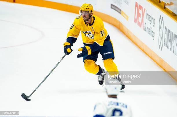 Roman Josi of the Nashville Predators skates with the puck during a NHL preseason game against the Tampa Bay Lightning at Bridgestone Arena on...