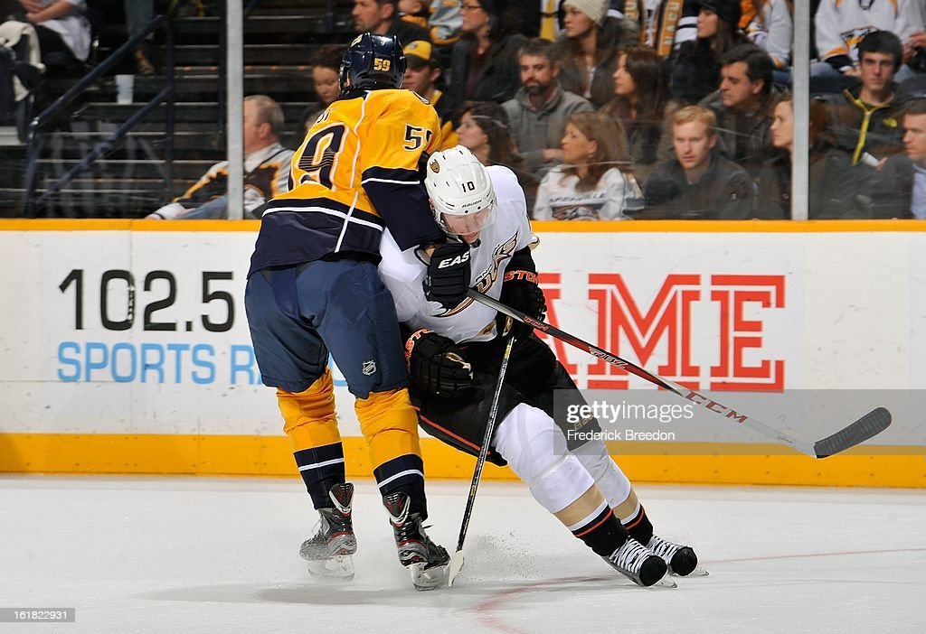 <a gi-track='captionPersonalityLinkClicked' href=/galleries/search?phrase=Roman+Josi&family=editorial&specificpeople=4247871 ng-click='$event.stopPropagation()'>Roman Josi</a> #59 of the Nashville Predators ties up <a gi-track='captionPersonalityLinkClicked' href=/galleries/search?phrase=Corey+Perry&family=editorial&specificpeople=213864 ng-click='$event.stopPropagation()'>Corey Perry</a> #10 of the Anaheim Ducks at the Bridgestone Arena on February 16, 2013 in Nashville, Tennessee.