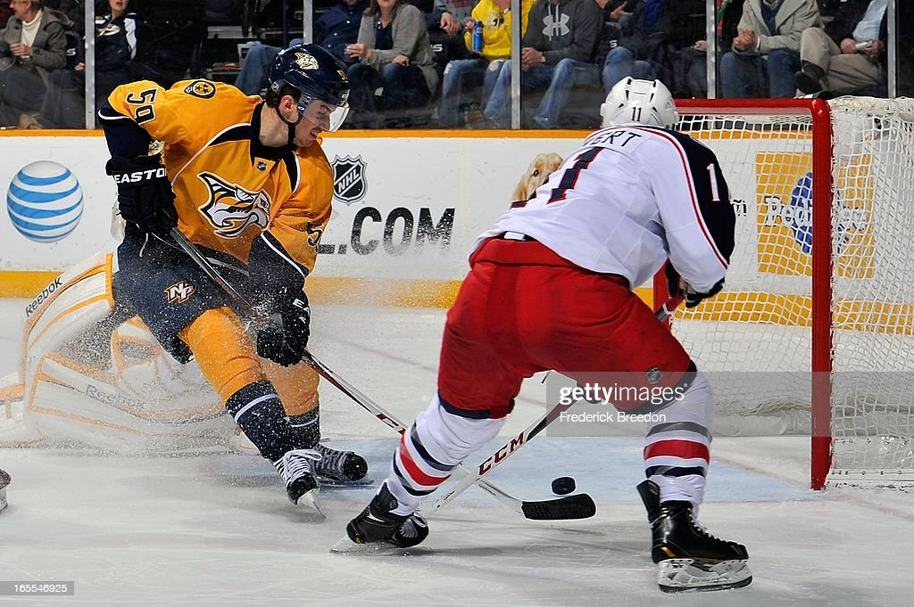 <a gi-track='captionPersonalityLinkClicked' href=/galleries/search?phrase=Roman+Josi&family=editorial&specificpeople=4247871 ng-click='$event.stopPropagation()'>Roman Josi</a> #59 of the Nashville Predators watches the puck bounce off the skate of Matt Calvert #11 of the Columbus Blue Jackets into the net at the Bridgestone Arena on April 4, 2013 in Nashville, Tennessee. The goal was waived off for being kicked in.