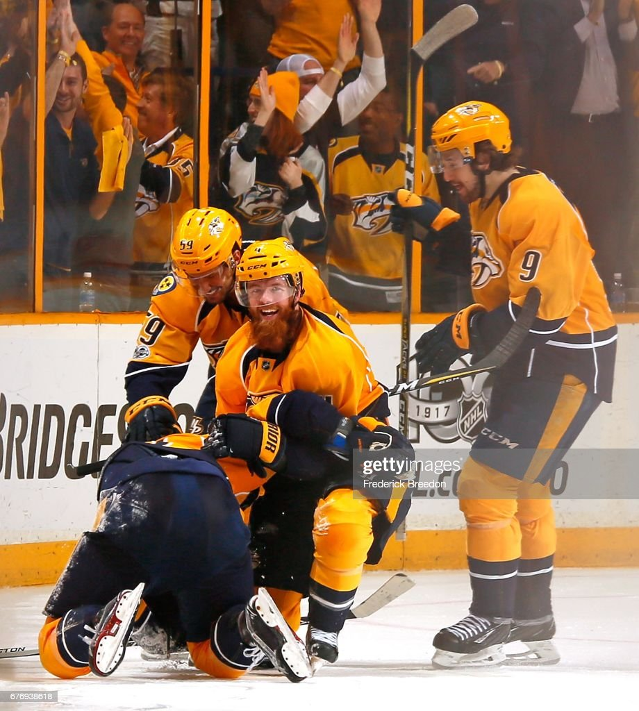 Roman Josi #59, Ryan Ellis #4, and Filip Forsberg #9 of the Nashville Predators congratulate teammate James Neal #18 on scoring a goal against the St. Louis Blues during the third period of Game Four of the Western Conference Second Round during the 2017 NHL Stanley Cup Playoffs at Bridgestone Arena on May 2, 2017 in Nashville, Tennessee.