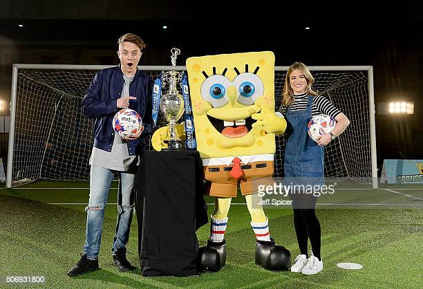 Roman Kemp Spongebob Squarepants and Rachel Stringer pose for a photo with the Champions League cup as 15 mascots from The Football League take part...