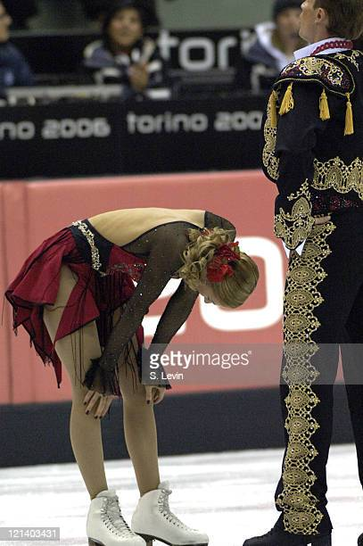 Roman Kostomarov and Tatiana Navka of Russia catch their breath after their gold medal wining performance during the Ice Dancing Free Skate Program...