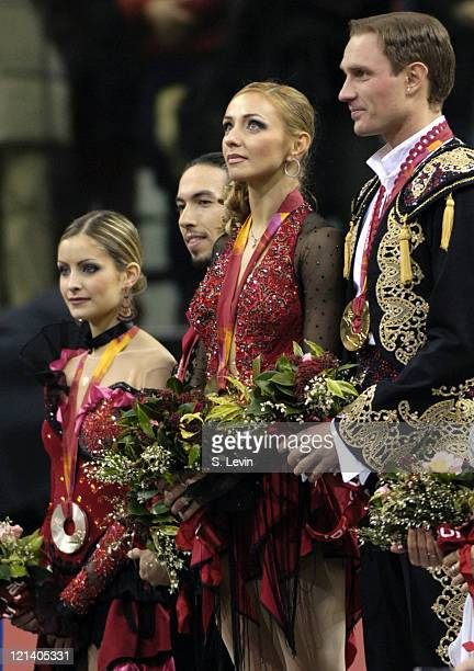 Roman Kostomarov and Tatiana Navka of Russia on the medal stand during the Ice Dancing Free Skate Program at the 2006 Olympic Games at the Palavela...