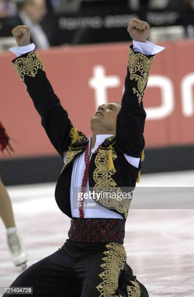 Roman Kostomarov of Russia collapses to his knees after his performace during the Ice Dancing Free Skate Program at the 2006 Olympic Games at the...