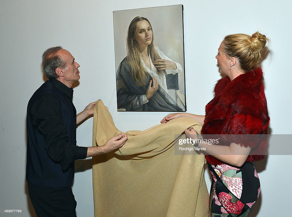 Roman Kriheli and Angela Birdman attend the Roman Kriheli Un:veiled Exhibit At Avant Gallery, Featuring The Unveiling Of 'The Most Beautiful Woman In The World' Painting at Epic Hotel on December 3, 2013 in Miami, Florida.