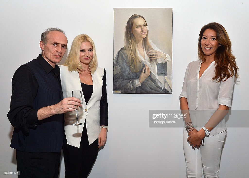 Roman Kriheli, Valeria Mola and Melodie Marin attend the Roman Kriheli Un:veiled Exhibit At Avant Gallery, Featuring The Unveiling Of 'The Most Beautiful Woman In The World' Painting at Epic Hotel on December 3, 2013 in Miami, Florida.