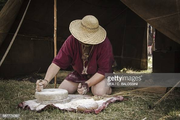 A Roman Legionary Using Grindstone To Make Flour Pictures