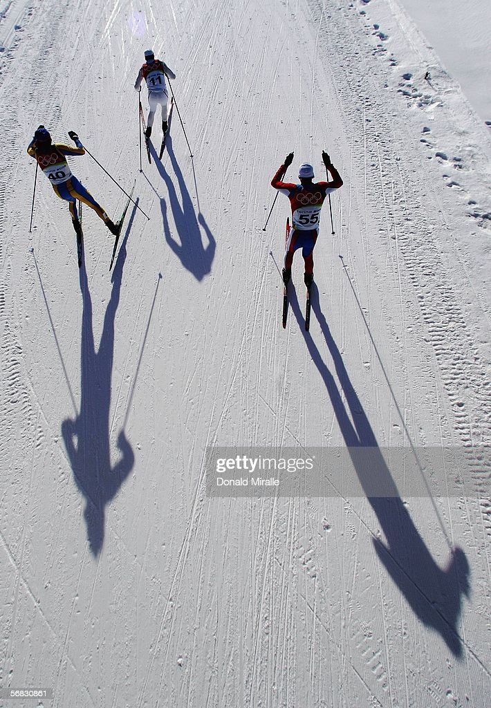 Roman Leybyuk of the Ukraine Emmanuel Jonnier of France and Nejc Brodar of Slovenia compete in the Mens Cross Country Skiing 30km Pursuit Final on...