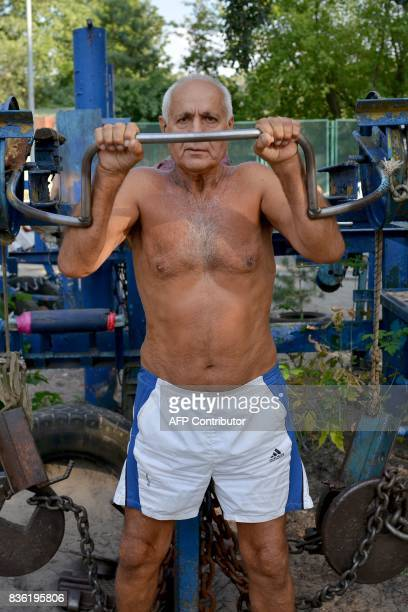 Roman lifts weights on August 18 2017 at an open air gym in Ukraine's capital Kiev Foundedin the 1970s the busy open air gym called Kachalka in...