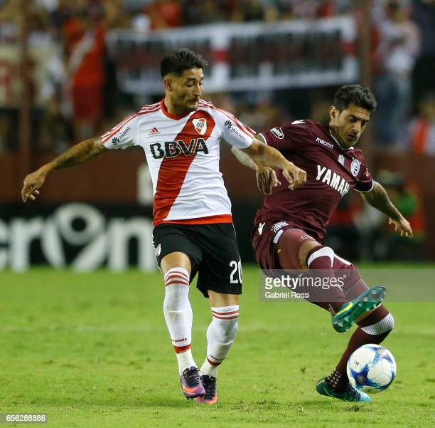 Roman Martinez of Lanus fights for the ball with Milton Casco of River Plate during a match between Lanus and River Plate as part of Torneo Primera...