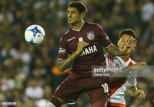 Roman Martinez of Lanus fights for the ball with Sebastian Driussi of River Plate during a match between Lanus and River Plate as part of Torneo...