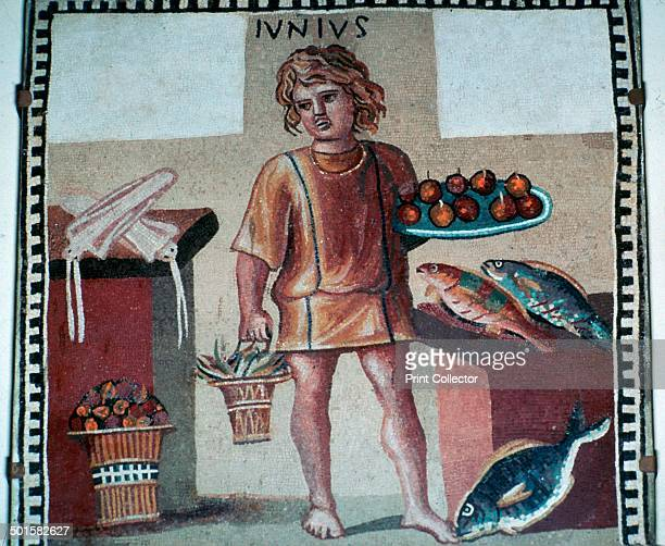 Roman mosaic from Pompeii of a boy slave in a kitchen with fruit and fish Now in the Hermitage Museum in St Petersburg 1st century