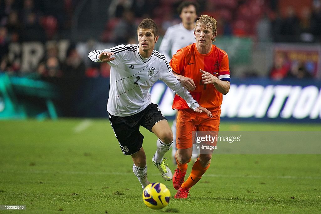 Roman Neustadter of Germany, Dirk Kuyt of Holland during the Friendly match between Holland and Germany at the Amsterdam Arena on November 14, 2012 in Amsterdam, The Netherlands.