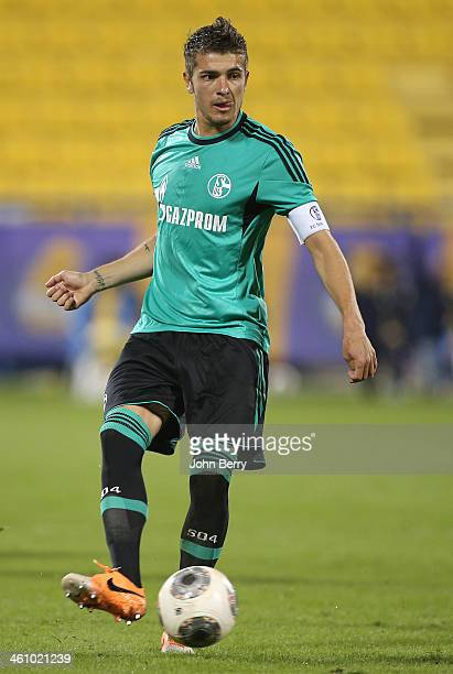 Roman Neustadter of Schalke in action during the friendly match between Al Gharafa SC and Schalke 04 at the Al Gharafa Stadium on January 6 2014 in...