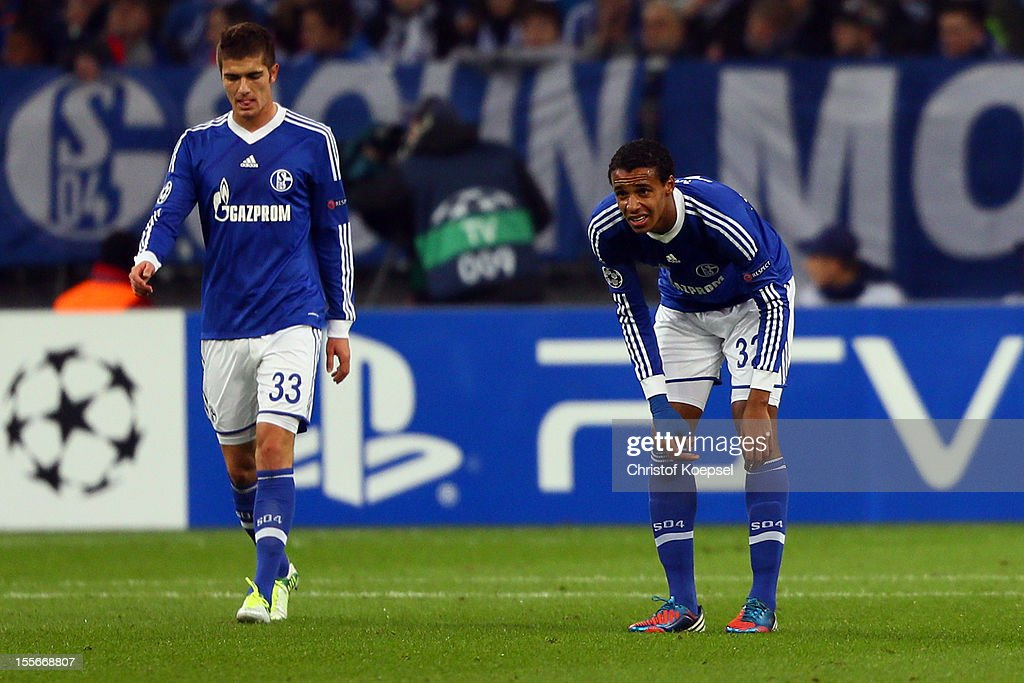 Roman Neustaedter and <a gi-track='captionPersonalityLinkClicked' href=/galleries/search?phrase=Joel+Matip&family=editorial&specificpeople=4462851 ng-click='$event.stopPropagation()'>Joel Matip</a> of Schalke look dejected after the first goal of Arsenal during the UEFA Champions League group B match between FC Schalke 04 and Arsenal FC at Veltins Arena on November 6, 2012 in Gelsenkirchen, Germany.