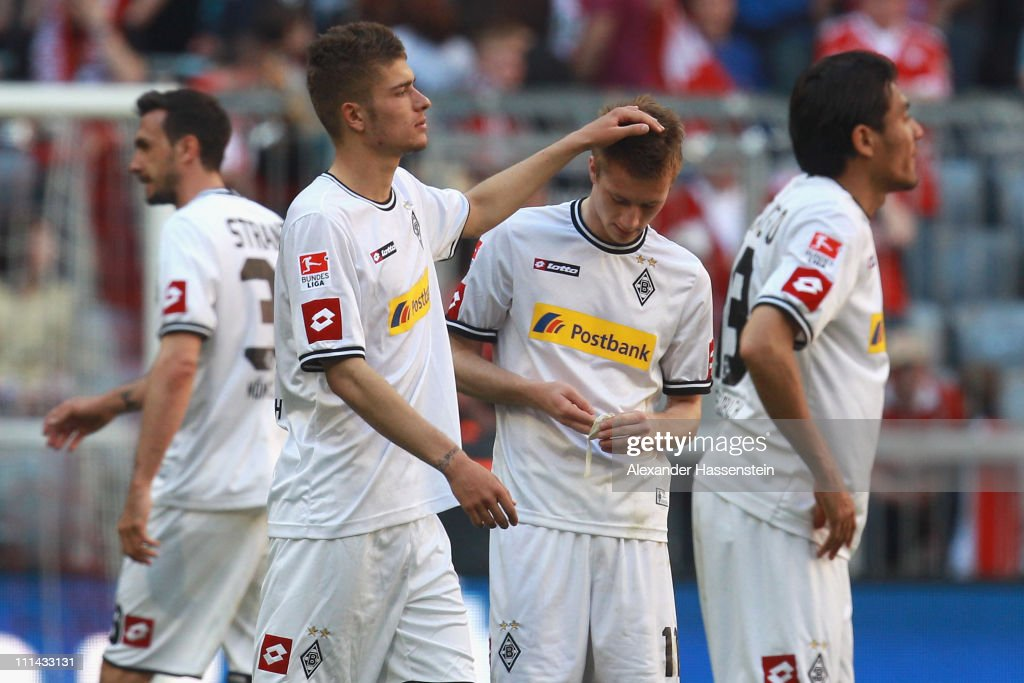 Roman Neustaedter (2nd L) of Gladbach reacts with his team mate <a gi-track='captionPersonalityLinkClicked' href=/galleries/search?phrase=Marco+Reus&family=editorial&specificpeople=5445884 ng-click='$event.stopPropagation()'>Marco Reus</a> (2nd R) after the Bundesliga match between FC Bayern Muenchen and Borussia Moenchengladbach at Allianz Arena on April 2, 2011 in Munich, Germany.