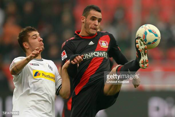 Roman Neustaedter of Moenchengladbach challenges Renato Augusto of Leverkusen during the Bundesliga match between Bayer 04 Leverkusen and Borussia...