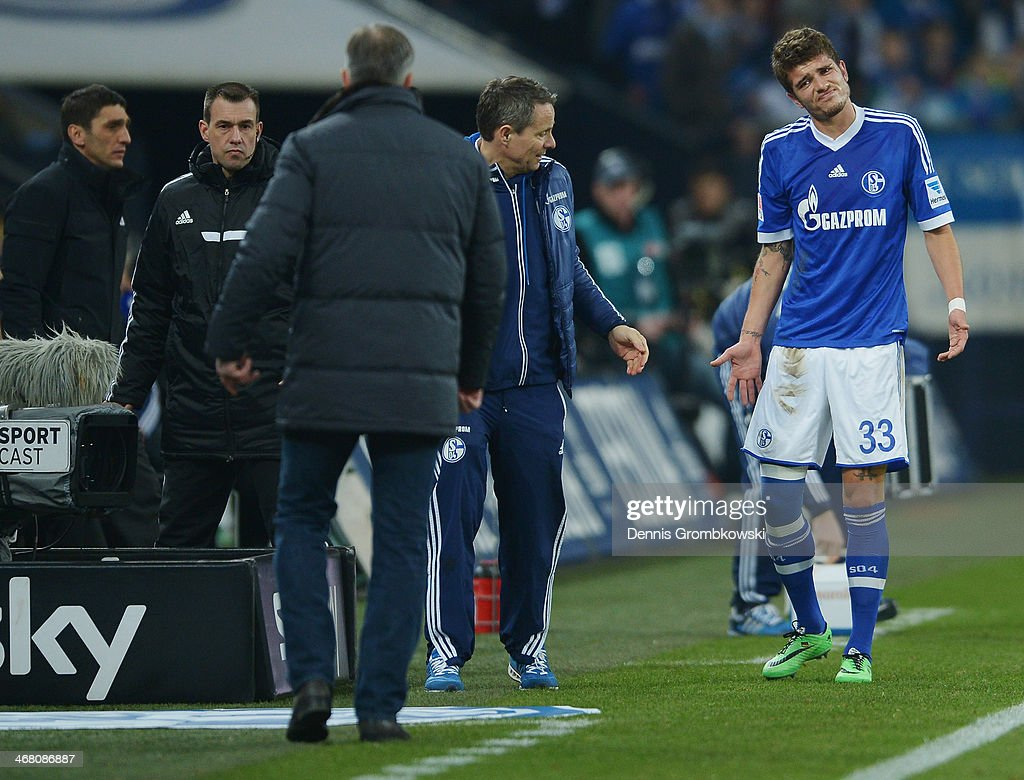 Roman Neustaedter of Schalke 04 reacts after suffering an injury during the Bundesliga match between FC Schalke 04 and Hannover 96 at Veltins-Arena on February 9, 2014 in Gelsenkirchen, Germany.