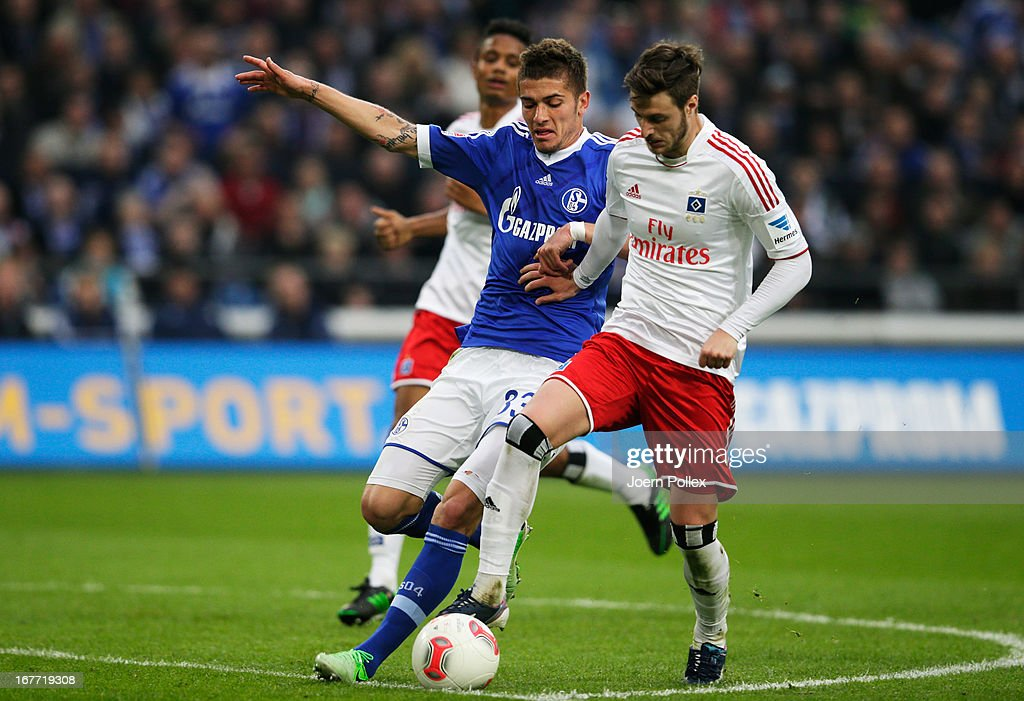 <a gi-track='captionPersonalityLinkClicked' href=/galleries/search?phrase=Roman+Neustaedter&family=editorial&specificpeople=5437402 ng-click='$event.stopPropagation()'>Roman Neustaedter</a> (R) of Schalke and Jacopo Sala of Hamburg compete for the ball during the Bundesliga match between FC Schalke 04 and Hamburger SV at Veltins-Arena on April 28, 2013 in Gelsenkirchen, Germany.