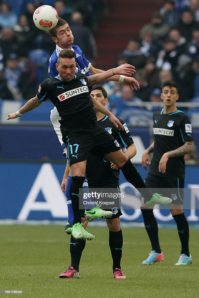 Roman Neustaedter of Schalke and <a gi-track='captionPersonalityLinkClicked' href=/galleries/search?phrase=Tobias+Weis&family=editorial&specificpeople=4401195 ng-click='$event.stopPropagation()'>Tobias Weis</a> of Hoffenheim go up for a header during the Bundesliga match between FC Schalke 04 and TSG 1899 Hoffenheim at Veltins-Arena on March 30, 2013 in Gelsenkirchen, Germany.