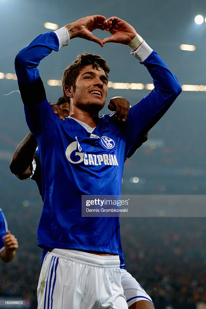 <a gi-track='captionPersonalityLinkClicked' href=/galleries/search?phrase=Roman+Neustaedter&family=editorial&specificpeople=5437402 ng-click='$event.stopPropagation()'>Roman Neustaedter</a> of Schalke celebrates after scoring his team's first goal during the UEFA Champions League round of 16 second leg match between Schalke 04 and Galatasaray AS at Veltins-Arena on March 12, 2013 in Gelsenkirchen, Germany.