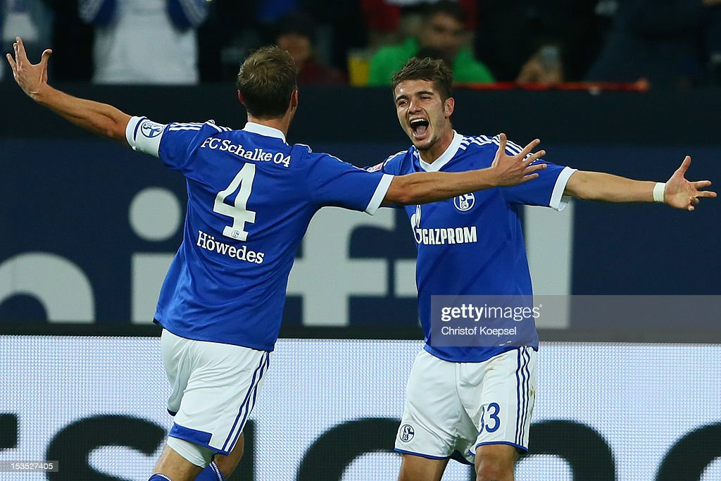 <a gi-track='captionPersonalityLinkClicked' href=/galleries/search?phrase=Roman+Neustaedter&family=editorial&specificpeople=5437402 ng-click='$event.stopPropagation()'>Roman Neustaedter</a> of Schalke (R) celebrates the third goal with <a gi-track='captionPersonalityLinkClicked' href=/galleries/search?phrase=Benedikt+Hoewedes&family=editorial&specificpeople=3945465 ng-click='$event.stopPropagation()'>Benedikt Hoewedes</a> (L) during the Bundesliga match between FC Schalke 04 and VfL Wolfsburg at Veltins-Arena on October 6, 2012 in Gelsenkirchen, Germany.