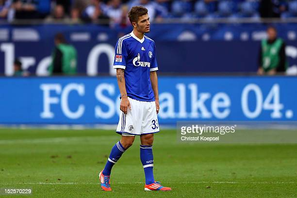Roman Neustaedter of Schalke looks dejected after losing 02 the Bundesliga match between FC Schalke 04 and FC Bayern Muenchen at VeltinsArena on...