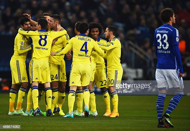 Roman Neustaedter of Schalke looks dejected as Chelsea players celebrate as John Terry scores their first goal during the UEFA Champions League Group...
