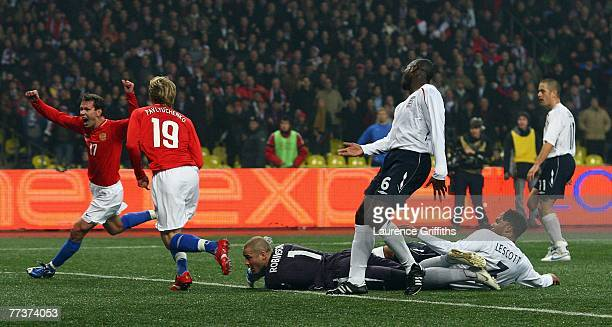 Roman Pavlyuchenko of Russia scores the second goal as Paul Robinson of England lies helplessly on the floor during the Euro 2008 qualifying match...