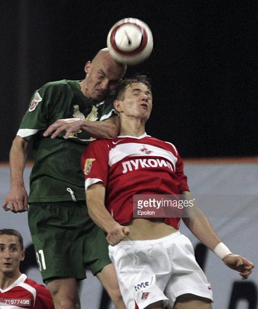 Roman Pavlyuchenko of Spartak Moscow competes for the ball with Gabriel Fernando of Rubin Kazan during the Football Russian League Championship match...