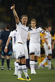 Roman Pavlyuchenko of Tottenham gives the thumbs up to the travelling supporters after the final whistle during the UEFA Champions League PlayOff...