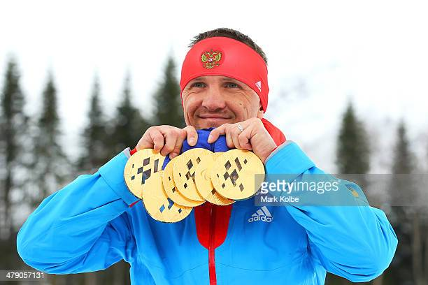 Roman Petushkov of Russia poses with the six gold medals won during the Sochi 2014 Paralympic Winter Games at Laura Crosscountry Ski and Biathlon...