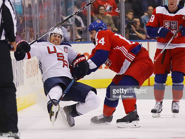 Roman Polak of Team Czech Republic checks Zach Parise of Team USA during the third period at the World Cup of Hockey tournament at the Air Canada...