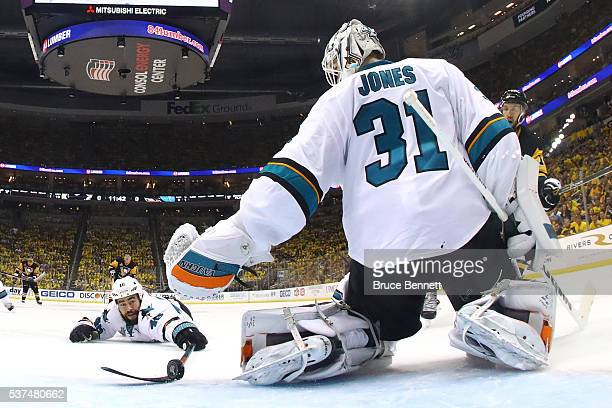 Roman Polak of the San Jose Sharks and Martin Jones attempt to block an assist by Nick Bonino of the Pittsburgh Penguins during the second period in...