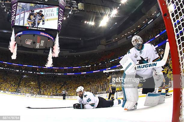 Roman Polak of the San Jose Sharks and Martin Jones react after a second period goal by Phil Kessel of the Pittsburgh Penguins in Game Two of the...