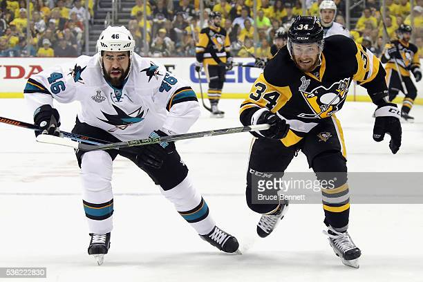 Roman Polak of the San Jose Sharks skates against Tom Kuhnhackl of the Pittsburgh Penguins in Game One of the 2016 NHL Stanley Cup Final at Consol...