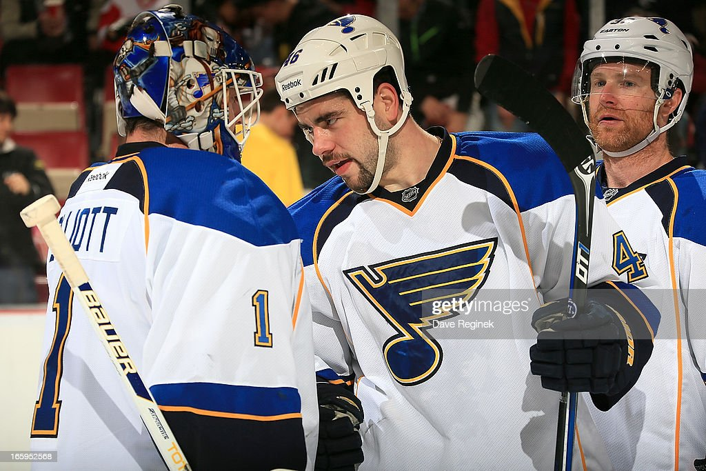 Roman Polak #46 of the St. Louis Blues congratulates teamate <a gi-track='captionPersonalityLinkClicked' href=/galleries/search?phrase=Brian+Elliott&family=editorial&specificpeople=687032 ng-click='$event.stopPropagation()'>Brian Elliott</a> #1 on his shut out after a NHL game against the Detroit Red Wings at Joe Louis Arena on April 7, 2013 in Detroit, Michigan. St. Louis defeated Detroit 1-0