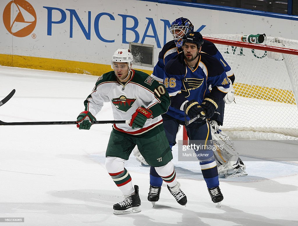 Roman Polak #46 of the St. Louis Blues defends against Devin Setoguchi #10 of the Minnesota Wild in an NHL game on January 27, 2013 at Scottrade Center in St. Louis, Missouri.