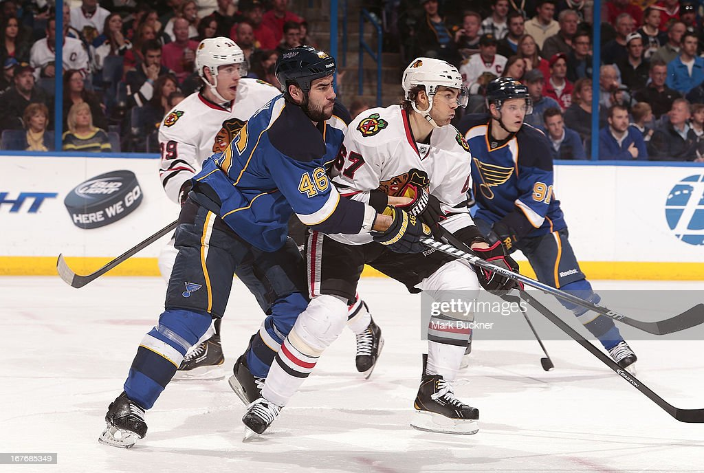 Roman Polak #46 of the St. Louis Blues defends against Michael Frolik #67 of the Chicago Blackhawks in an NHL game on April 27, 2013 at Scottrade Center in St. Louis, Missouri.