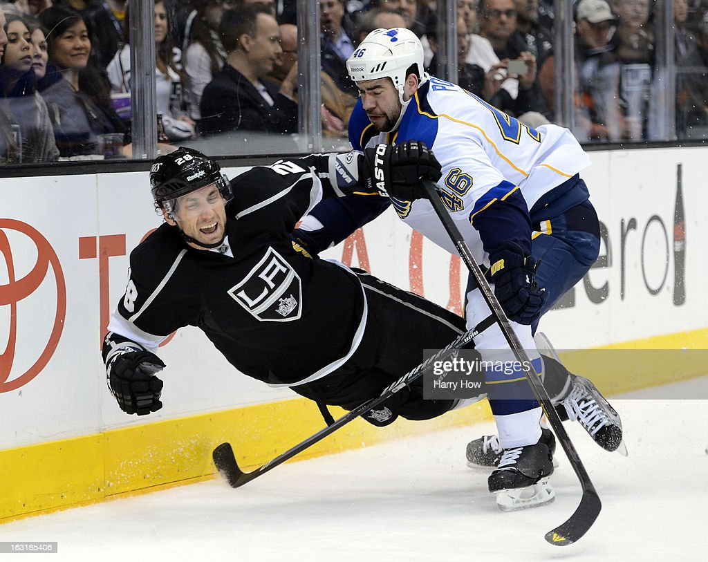 Roman Polak #46 of the St. Louis Blues holds Jarret Stoll #28 of the Los Angeles Kings resulting in a penalty during the second period at Staples Center on March 5, 2013 in Los Angeles, California.